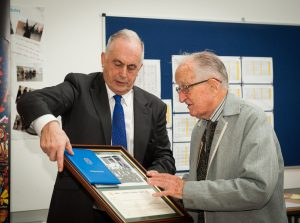 Br Donnelly, first headmaster receives a presentation from current school Principal, Mr David Neville