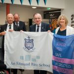 Mr Pat Keating ERST, Br Edmund Garvey, Christian Brothers and Ms Patricia McCrossan, with the Colaiste Choilm Flag